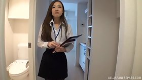 Japanese sales girl Saki Asumi drops on her knees to amuse a dick