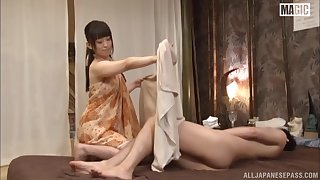 Asian masseuse is putting her soft hands to use and making a dick hard