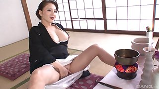 Mature Asian babe loves playing with her wet pussy hole