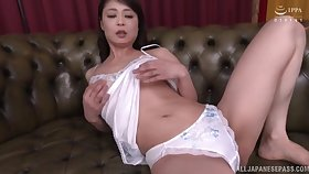 Mature Asian wife Ootomo Izumi levelling together with masturbating on the sofa